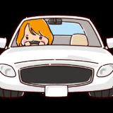 スポーツカーを運転する女性のイラスト